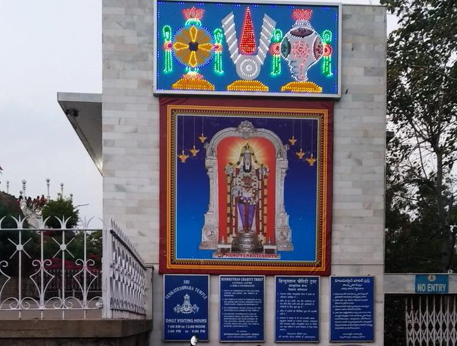 Public notices and photo of the presiding deity Lord Venkateshwara at Birla Temple, Hyderabad.
