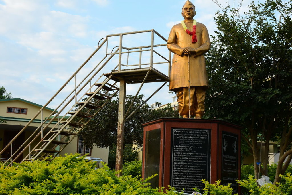 Sri Sailam : A park in front of our cottages in old age home. The life-size statue of the founder of this old age home can be seen here.