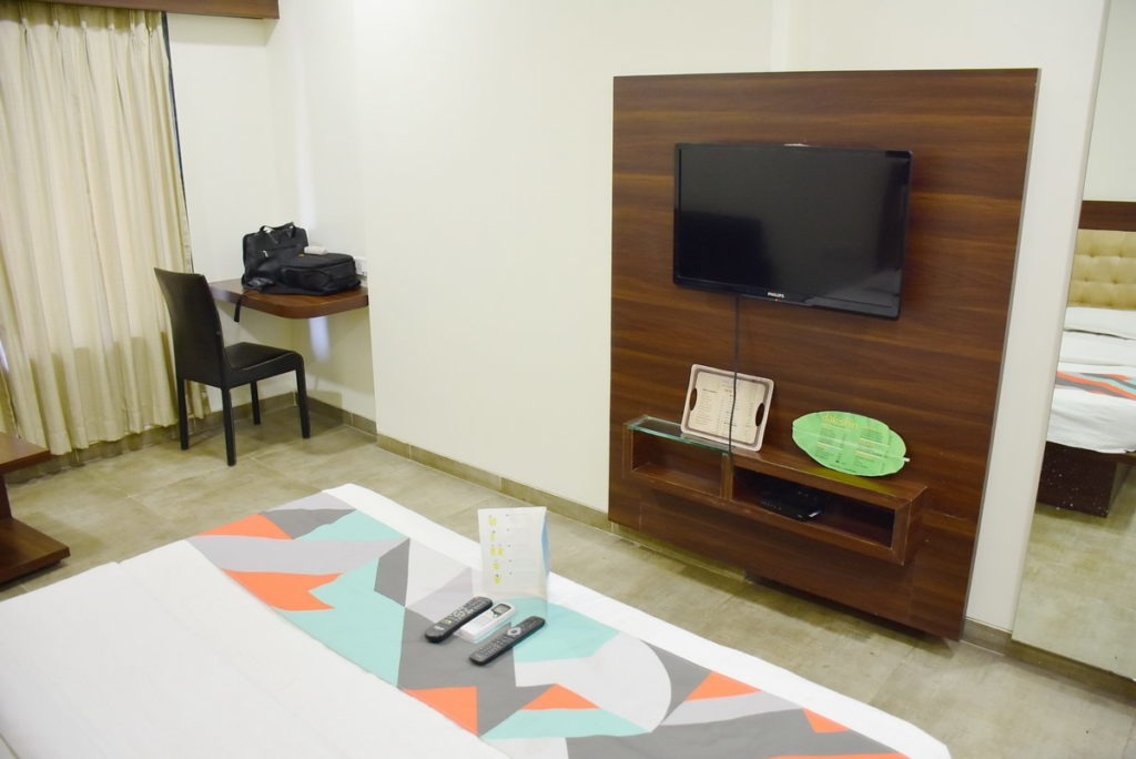 "Hotel FabExpress Global Inn Aurangabad -  Study Table, chair, flat 32"" TV, set top box etc."
