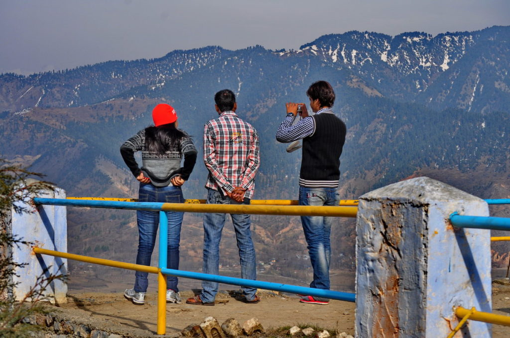 Tourists take a halt at Titanic View Point to enjoy the scenic views of snow capped mountains and winding roads down the valley.